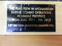 Plaque describing the history of the flag.